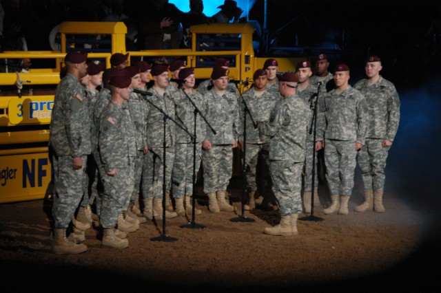 """Soldiers of the 82nd Airborne Division """"All American"""" Chorus sing the national anthem Dec. 9 during the Professional Rodeo Cowboy's Association championship at the Wrangler National Finals Rodeo in Las Vegas."""