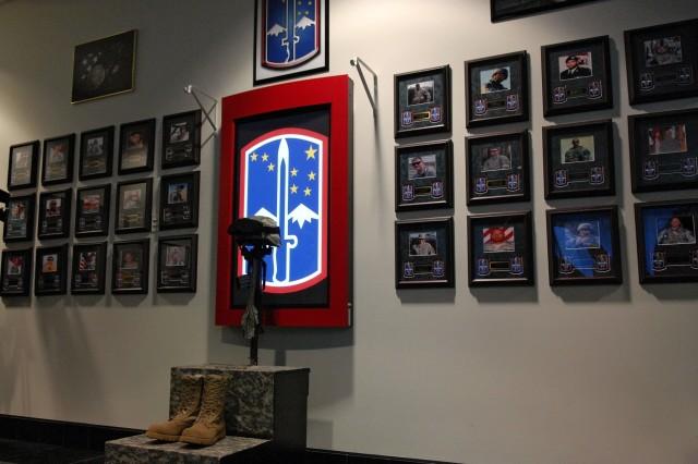 A Memorial Wall dedicated Dec. 12 at Fort Wainwright, Alaska, displays photos of fallen members of the 172nd Stryker Brigade Combat Team.