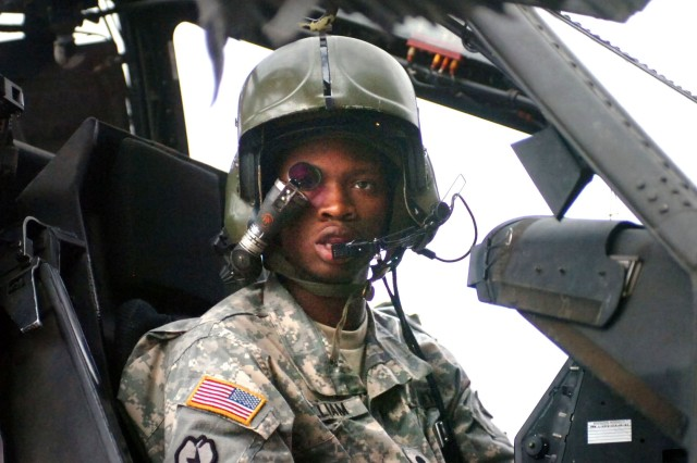 Spc. Kendrick William ensures the Apache's laser-guidance system is working properly.