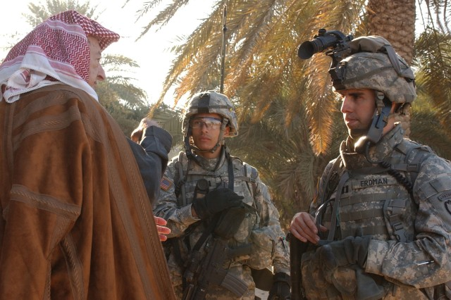 An understanding of the people and culture of the host country is an important aspect of counterinsurgency. Here, 1st Lt. Jeff Harris (center) and Capt. Robert Erdman explain to Sheik Ishmael Kaleel Gomar Al Dulayani what was found in houses belonging to members of his tribe during a cordon and search mission in Hawr Rajab, Baghdad, Nov. 29, 2006. The Soldiers are from Troop A, 1st Squadron, 40th Cavalry Regiment.