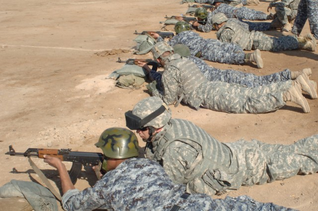 Soldiers from 2nd Brigade Combat Team, 2nd Infantry Division supervise Iraqi police officers during training at the marksmanship range at Camp Rustamiyah.