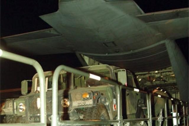 U.S. Army, Alaska Soldiers and their equipment board a C-130 aircraft Dec. 5 at Elmendorf Air Force Base, Alaska, for Exercise Vigilant Shield training at Fort Greely, Alaska.
