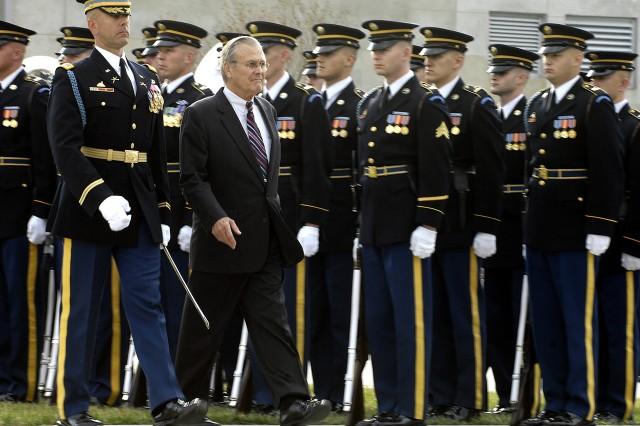 Secretary of Defense Donald H. Rumsfeld reviews the troops.