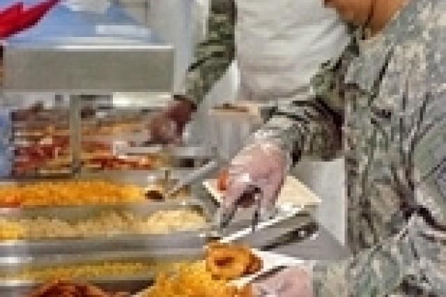 Cooks serve dinner at Forward Operating Base Brassfield-Mora, Iraq.