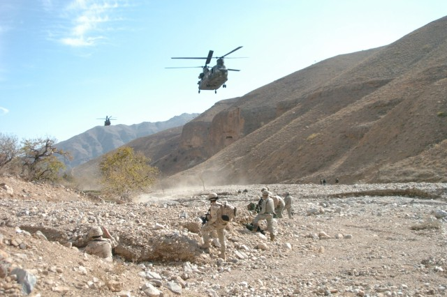 CH-47 Chinook helicopters prepare to pick up the Soldiers and Airmen.