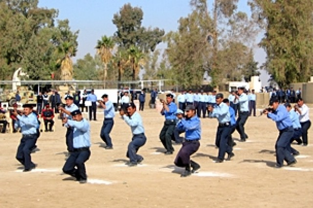 The recruits conduct three practical exercises during the graduation ceremony demonstrating their proficiency in self-defense, security, and teamwork. The new recruits come from many different areas of Iraq and learn to work together regardless of ethnicity.