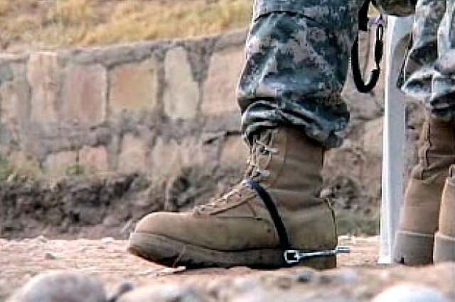 US Cavalry Soldier wears spurs earned by passing through a traditional US Cavalry right of passage.""