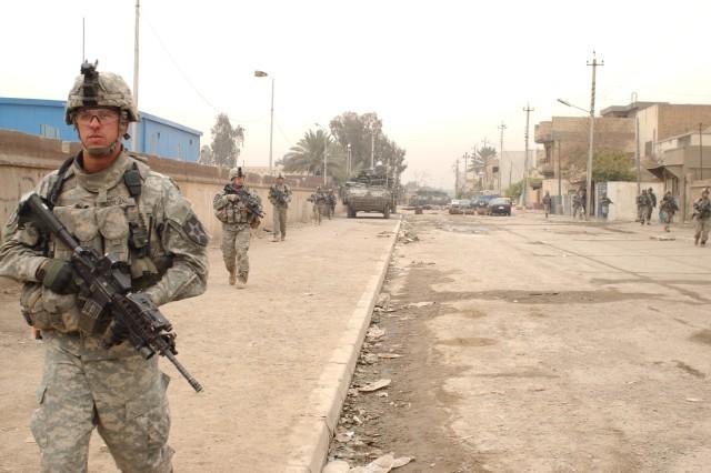Soldiers patrol the streets of Adhamiya.