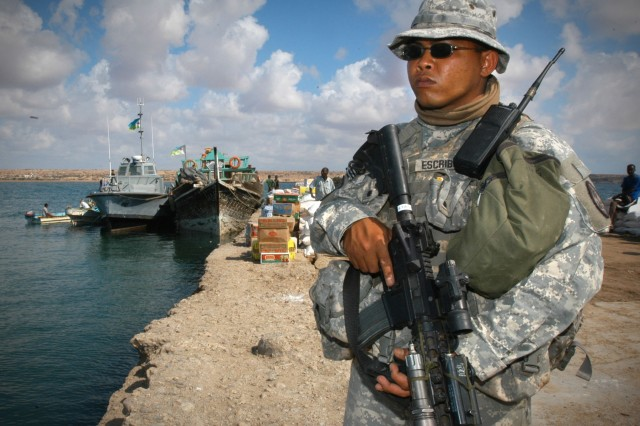 Spc. Phillip Escribano stands perimeter watch pierside in Obock, Djibouti, on Dec. 9. Ray is from the Guam National Guard and attached to Combined Joint Task Force - Horn of Africa.