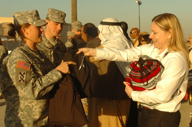Soldiers at Camp Arifjan, Kuwait receive donated holiday presents.