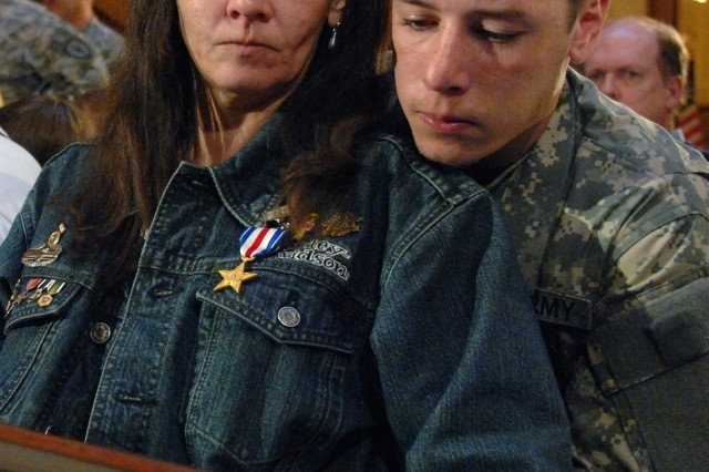 Beth Proctor and son, Pvt. Joseph Proctor, reflect on the memories of husband and father, Sgt. Joseph Proctor after the family received his Silver Star during a ceremony at the Indiana Statehouse Dec. 20, 2006.