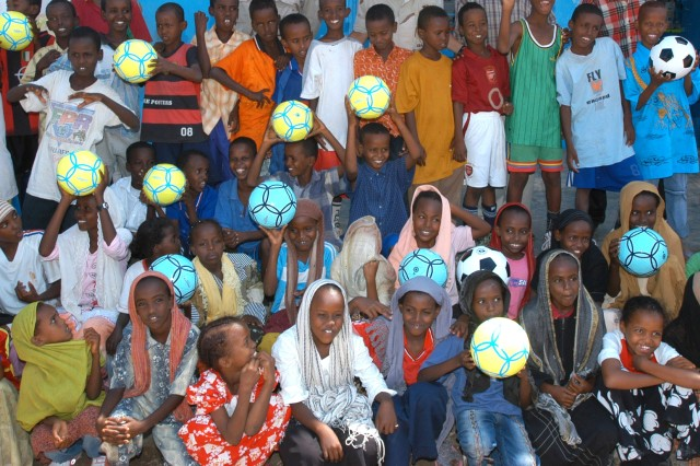 Children in Balbala, receive soccer balls, donated by schools, churches and other organizations in the United States and distributed by the Soldiers.