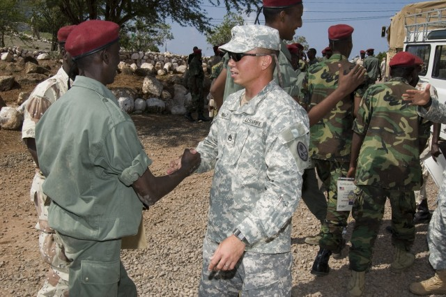 """Staff Sgt. Ramon Munoz congratulates a Djiboutian soldier on completion of his four-week counterterrorism training in Arta."""""""