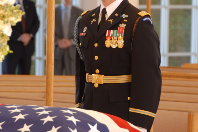 Capt. Christopher Brooke, from the 3rd U.S. Infantry Regiment, stands at attention at the casket of former President Gerald R. Ford during the arrival ceremony at St. Margaret's Episcopal Church in Palm Desert, Calif., Dec. 29.
