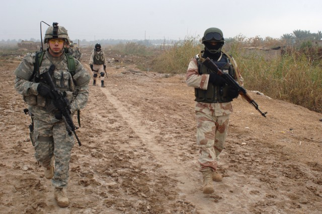Salman Pak Iraqi police and the U.S. Soldiers patrol the area together.