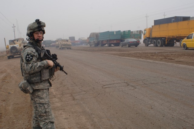 Staff Sgt. Peter Roberts provides security during a tactical halt.