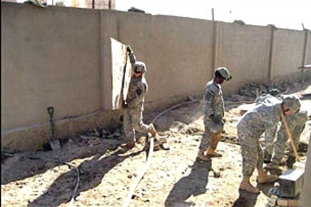 Soldiers with Company C, 1st Battalion, 9th Infantry Regiment, 2nd Brigade Combat Team, 2nd Infantry Division put their muscles into making Observation Point Trotter, their new home, a nicer place to live.