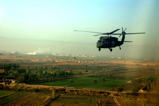 A UH-60 Black Hawk helicopter flies on a mission to Baghdad.