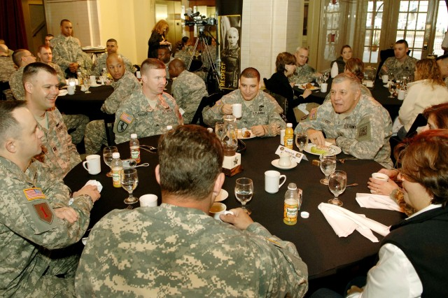 """Vice Chief of Staff of the Army Gen. Richard A. Cody talks to 'Soldier Heroes' during a breakfast at Sunset Station in San Antonio. Close to 90 Soldier 'heroes' who were awarded either the Silver Star, Distinguished Flying Cross, the Bronze Star or the Purple Heart were recognized during pre-game  activities during the Army-sponsored """"All-American"""" Bowl all-star high school football game."""