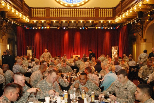 "Soldiers congregate for breakfast at the Sunset Station Saloon, once the San Antonio train station, before the start of Saturday's ""All-American"" Bowl football game.  Senior leaders such as the Secretary of the Army and the Army Vice Chief of Staff visited with 89 Soldier 'heroes' who were honored during  pre-game activities."""