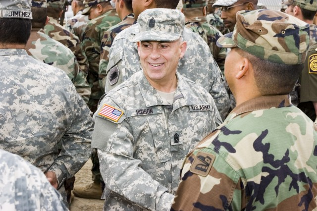 Command Sgt. Maj. David Hudson, senior enlisted advisor to Lt. Gen. H Steven Blum, the chief of the National Guard Bureau, talks with National Guard troops deployed to Operation Jump Start on the California border with Mexico.