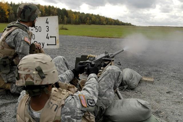 A  Soldier fires an M-2 machine gun to zero (adjust) the sites.
