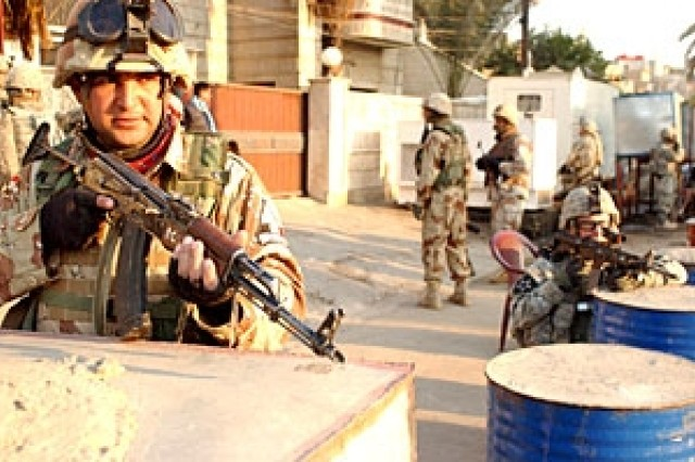 Iraqi and U.S. Soldiers from 5th Battalion, 20th Infantry Regiment, provide security during a mission to bring sectarian violence and insurgency activities down while increasing Iraqi security force capabilities in Adhamiya.