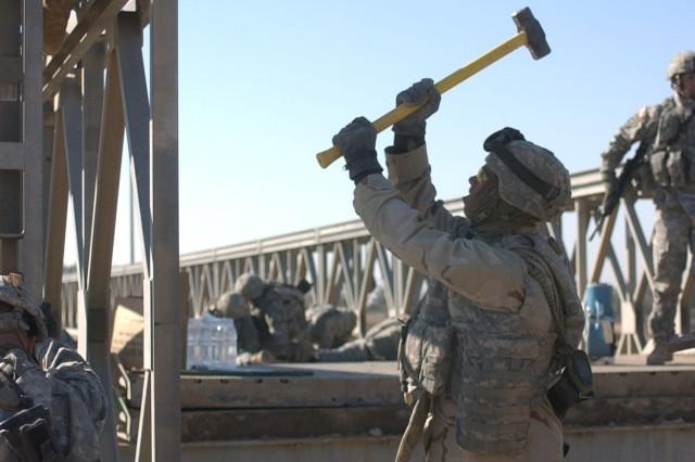 A sledgehammer is a handy tool when taking down a bridge.