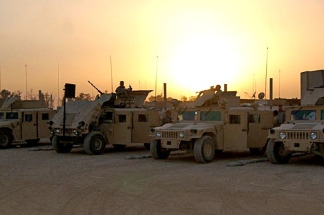 Soldiers of 2nd Battalion, 27th Infantry Regiment, 3rd Brigade Combat Team, 25th Infantry Division, prepare for an early morning mission at Forward Operating Base McHenry, Hawija, Iraq.
