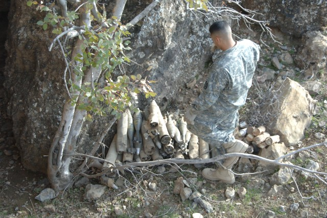Sgt. Angel Maldonado stacks mortar rounds, which will be blown in place by an ordnance team from the Air Force.