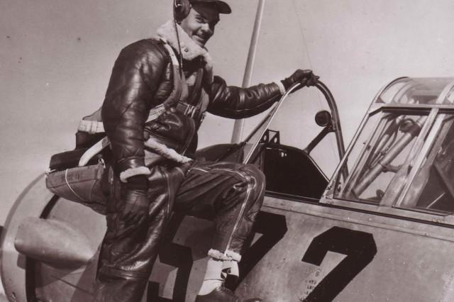 Capt. Benjamin Oliver Davis, Jr., of Washington D.C., climbing into an Advanced Trainer. Tuskegee, Alabama. January 1942.