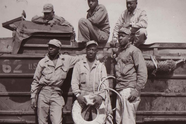 Six Soldiers pose for a photo while preparing for a rescue mission.