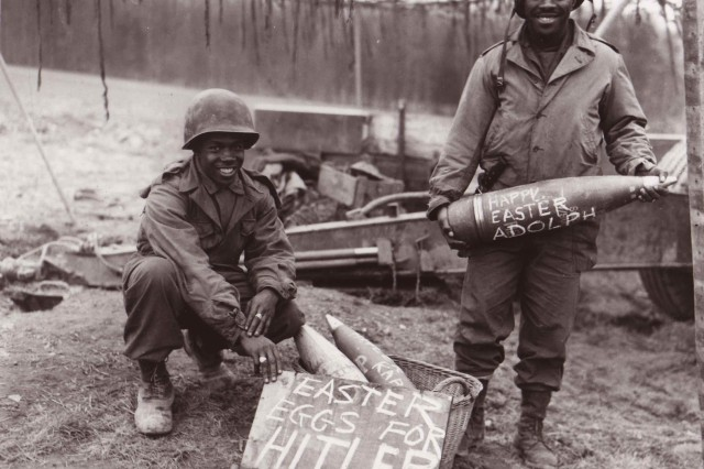 """Two Soldiers proudly show off their personalized """"Easter eggs"""" before firing them."""