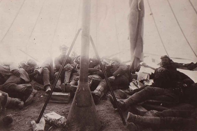 Buffalo Soldiers of the 25th Infantry Regiment take a break in a tent.