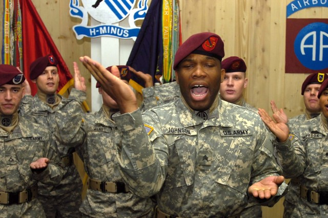 Sgt. James Johnson, from the 82nd Airborne Division's All American Chorus, leads a performance Jan. 13, at Contingency Operations Base Speicher, Iraq.