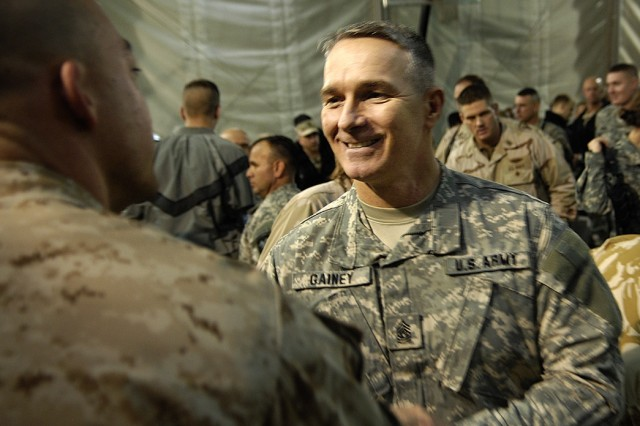 Command Sgt. Maj. William J. Gainey, senior enlisted advisor to Marine Gen. Peter Pace, chairman of the Joint Chiefs of Staff, thanks a Marine Corps first lieutenant and other deployed troops at Camp Eggers, Afghanistan, for their service.