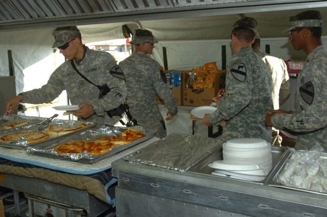 Taji Troops Enjoy Pizza from Home