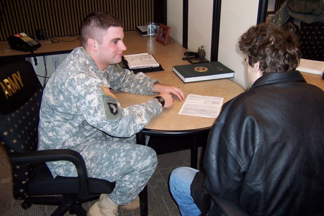 Sgt. Clint Griffin talks with a prospect at a recruiting station while working with the Special Recruiter Assistance Program in Seattle Battalion.