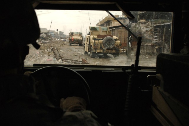 The Soldiers drive their Humvees to the area they will patrol.