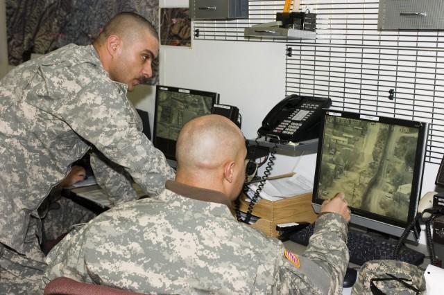 National Guard Soldiers discuss live border surveillance images.