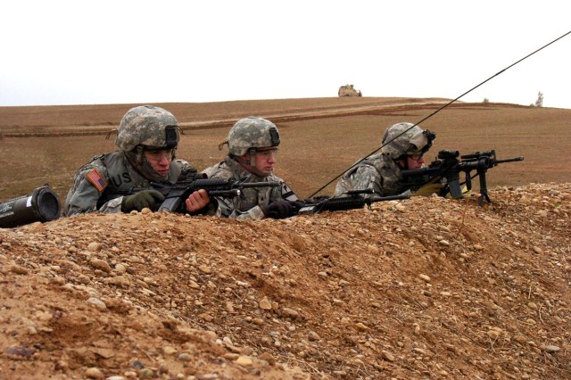 Soldiers from the 7th Cavalry Regiment, 1st Cavalry Division provide security for fellow Soldiers during a cordon and search operation near Tal Aswad, Iraq, Jan. 12.