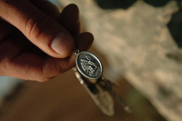 Spc. Matthew Plumlee carries a St. Michael's medallion, given to him by a chaplain who told him St. Michael was the patron saint of paratroopers. Plumlee, a military policeman with Special Troops Battalion, 2nd Brigade Combat Team, 82nd Airborne Division, wears the medallion with his dog tags when he goes out on patrols.