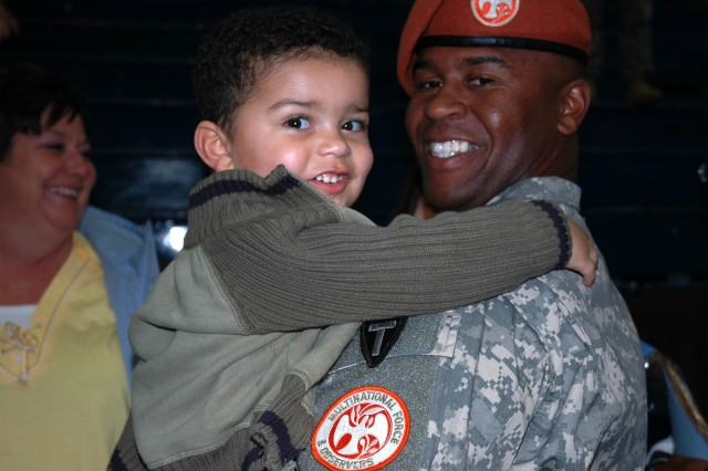 A young boy embraces his father who is a member of the Texas Army National Guard's 124th Cavalry Regiment, 36th Infantry Division, during an official welcome-home ceremony held at Abrams Field House, Fort Hood, Texas, Jan. 23. Sergeant Flores has just completed a yearlong deployment in the Sinai, Egypt, as part of the Multinational Force and Observers peacekeeping mission.