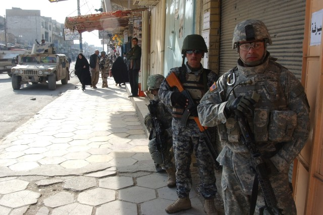The Iraqi and U.S. Soldiers work as a team in the complex urban environment.