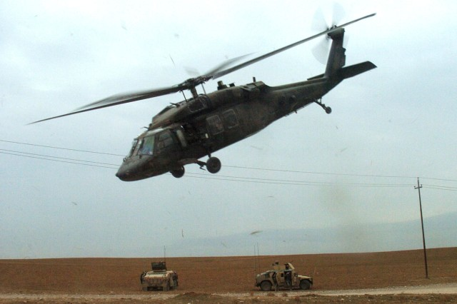A Black Hawk helicopter takes off after picking up Soldiers from 2nd Battalion, 7th Cavalry Regiment in Tal Aswad, Iraq, following a cordon and search operation Jan. 12.