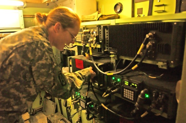 Staff Sgt. Chastity Morin, the senior information systems operator-analyst for Company C, 2nd Brigade Special Troops Battalion, 2nd Brigade Combat Team, 10th Mountain Division, performs preventive maintenance checks and services on radio transmitters in the BCT's main communications hub on Camp Striker, Iraq, Jan. 23.