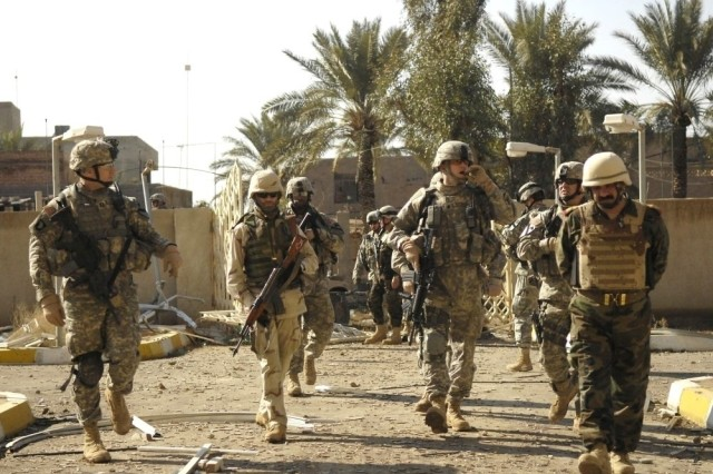 The Iraqi and U.S. Soldiers head back to base after a successful mission.
