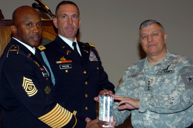 Army Vice Chief of Staff Gen. Richard Cody presents the Association of the U.S. Army, George Washington Chapter's Commander-in-Chief Award to Col Bob Pricone and Command Sgt. Major Craig Roberson, Commander and Command Sergeant Major of the 3rd U.S. Infantry Regiment (The Old Guard).  The Old Guard is the first military unit to ever receive this award; previous recipients include Gen. Colin Powell, William J. Perry, and Robert J. Dole.