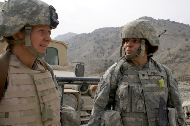 Oregon Army National Guard Staff Sgt. Jo Turner (left) and Spc. Cheryl Ivanov are battle buddies who stick together and help each other cope with the emotional and mental stress of combat operations in Afghanistan.