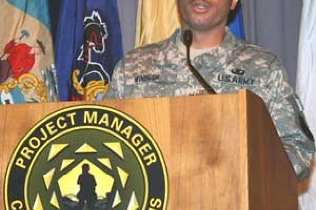 Lt. Col. James O. Winbush Jr. speaks during the Product Manager Intelligent Munitions System assumption-of-charter ceremony here Dec. 8.